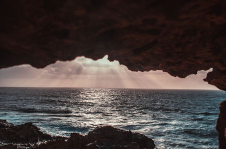 landscape of island and ocean (Fuerteventura) - sunset: sunbeam and clouds