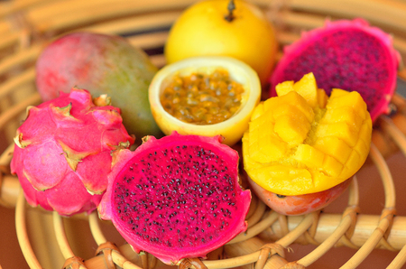 exotic fruits: mango, passion fruit, dragon fruit on the table. still life.