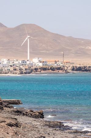 windmill on the beach of ocean