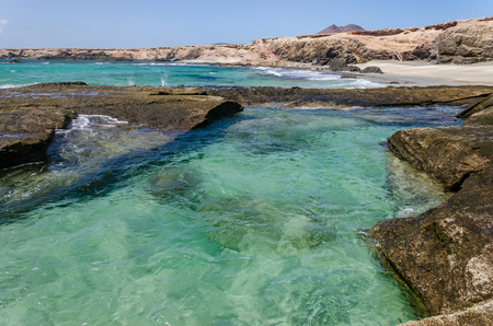 landscape. Blue ocean and natural pool on the beach of island Fuerteventura. Spain