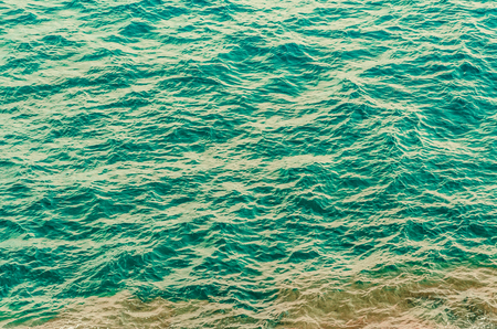 green water of ocean with small waves