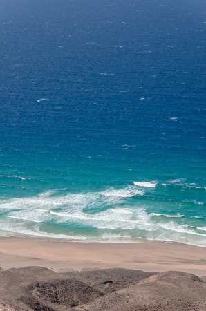 ocean landscape. blue and deep blue water of ocean and sand beach with surf wave Banco de Imagens
