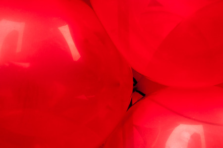 are taken: Balloons RED round  balloons close up.  Picture taken in San Francisco pride parade
