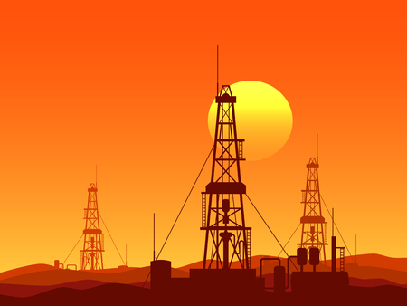 Oil and gas rigs over orange desert sunset