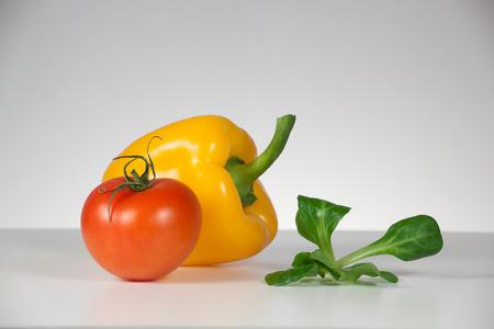 capsicum: Tomato and capsicum in the kitchen