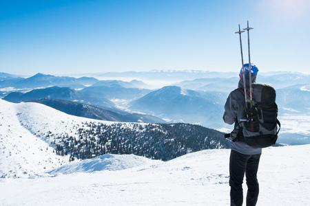 the snowy mountains: Tourist athlete on snowy mountains Stock Photo