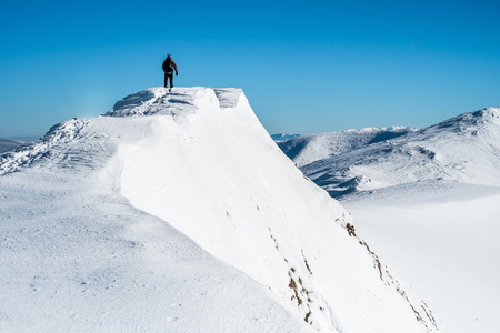 tops: Man on top of mountain Stock Photo