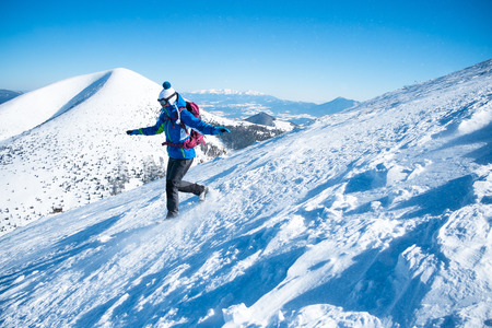 descending: woman descending from snowy mountains