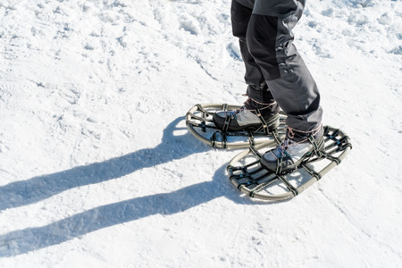 snowshoes: Girl with snowshoes Stock Photo