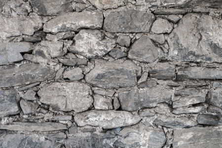 uncouth: stone wall with a rough texture Stock Photo