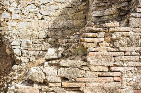 old brick wall: old ruined brick wall
