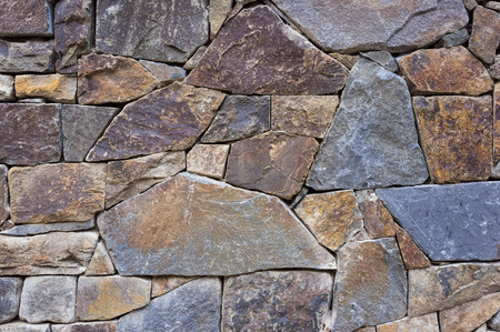 uncouth: detail outdoor stone wall, jointless Stock Photo