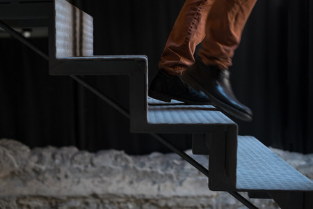 dungeons: Man fleeing down the stairs Stock Photo
