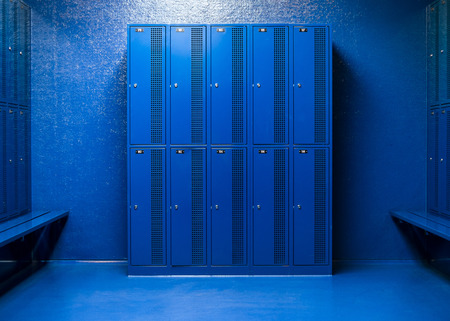 affairs: blue room with desks and school lockers for security affairs schoolchildren