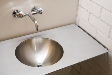 vandal: Modern metal sink, vandal washbasin, stainless steel sanitary equipment Stock Photo