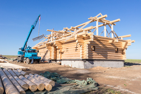 Construction of a wooden house in nature Stock Photo