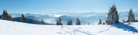skiers: Panoramic view snowcapped mountains, european beautiful winter mountains, slope for skiers, Alpine mountains in winter Stock Photo