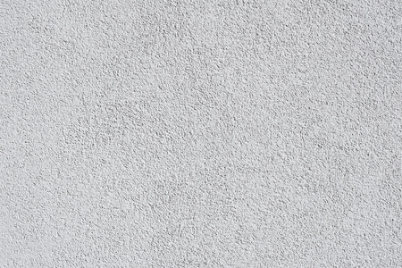 gray exterior walls plastered, painted white, moderately coarse texture