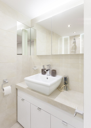 Bathroom with washbasin, modern bathroom, bright interior, equipped bathroom in the apartment, small and cozy bathroom