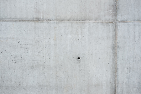 Detail of concrete wall background, gray monolithic concrete, concrete symbol 版權商用圖片