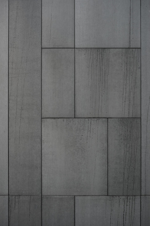 Modern facade, black cladding boards, cement cladding panels, gray panels