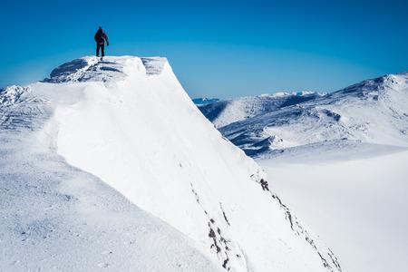 Alone hiker on mountain top, Mountaineer go top mountain, Man on top, Walker in European winter mountains, Symbol of freedom man, Human on mountain
