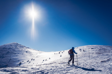 Winter sport for one, Winter winter sport, Symbol of winter sports in the mountains Skialpinist on snowy mountains