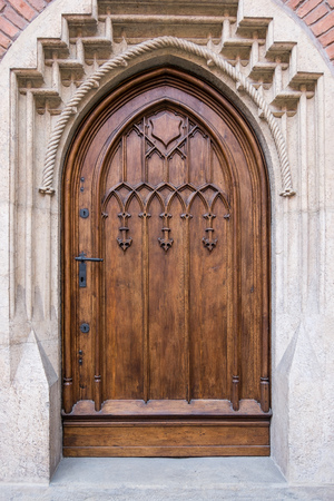 Renovated old door, gothic wooden doors, stone portal with doors, broken arch 版權商用圖片