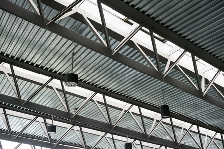 Modern steel roof construction, Iron work, Construction tin roofs, Skylights in roof, ceiling construction, Lattice iron structure of roof with skylights