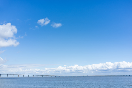Long bridge in the sea, Beautiful summer sky with a minimalist bridge, Background with bridge, Summer positive background architecture