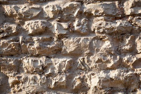 Wall of untreated stone, Details rustic stone wall and mortar, Massive stone walls