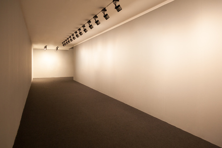 Presentation room with beige lighted walls, Empty wall for images in perspective, Exhibition room lights, White showroom perspective, Showroom for images