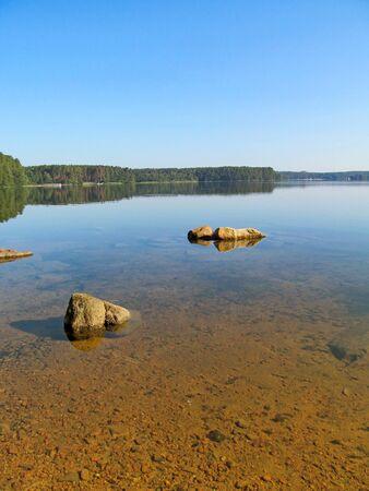 Summer idyllic landscape with beautiful lake.