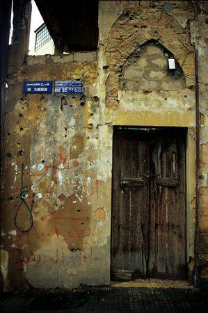 beirut: wooden door of an old abandoned house from the civil war era in beirut in lebanon