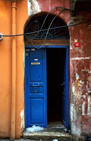 blue door on a red wall photo