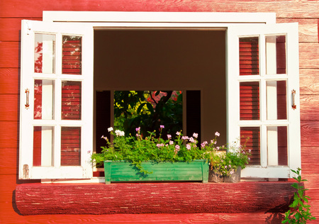 exterior wall: window with flower box Stock Photo