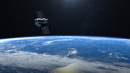 Satellite is orbiting the Earth. The satellite is flying to the right. Stock Photo