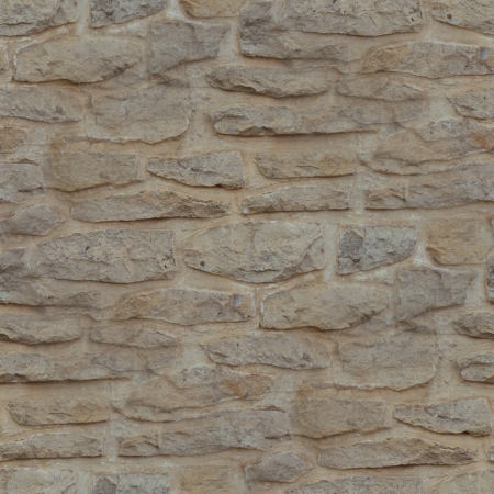 Rubble stone wall seamless background photo