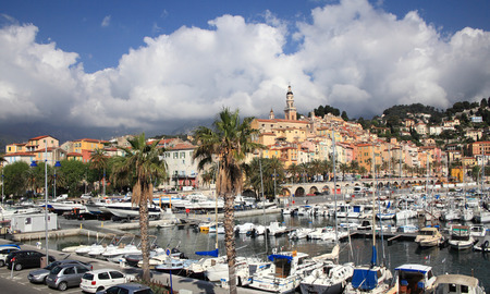 menton: MENTON FRANCE  APRIL 30 2015: Menton cityscape and harbour on April 30 2015 in Menton France. It is a popular tourist resort on French Riviera.