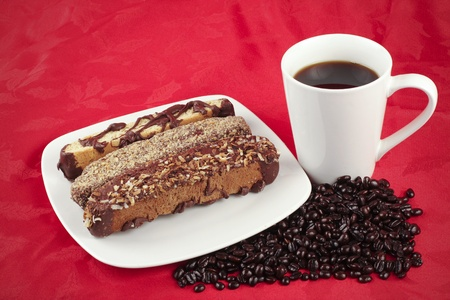 caffiene: Coffee and Biscotti on a red textured background