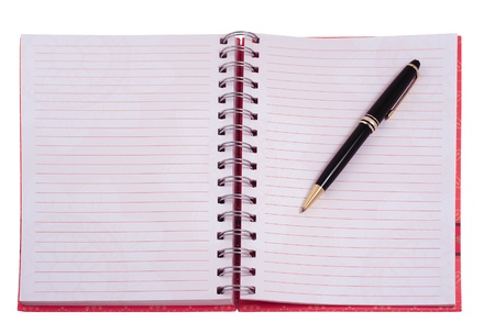 An open notebook showing two blank pages with a pen on one page isolated on white photo