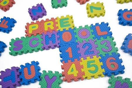 Preschool and numbers written in foam letters on white background