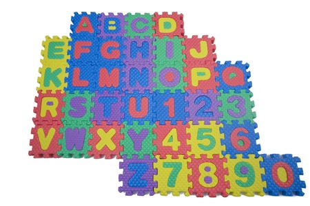 Foam letters and numbers isolated on white background Stock Photo
