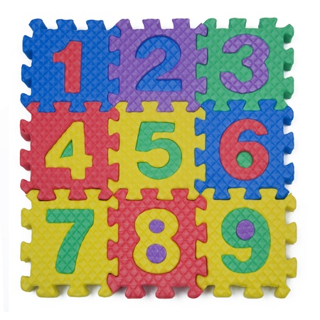A childs number puzzle on white background photo