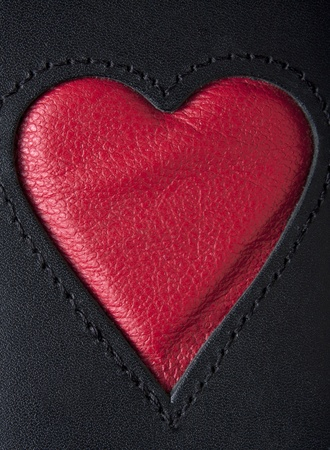 stitching: Leather heart symbol red on black stiched Stock Photo