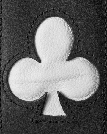 Poker clubs shape stitched in leather black and white photo