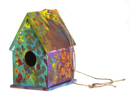 Colorful finished childs painted birdhouse isolated on white photo