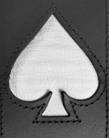 Spades symbol stitched in leather close up