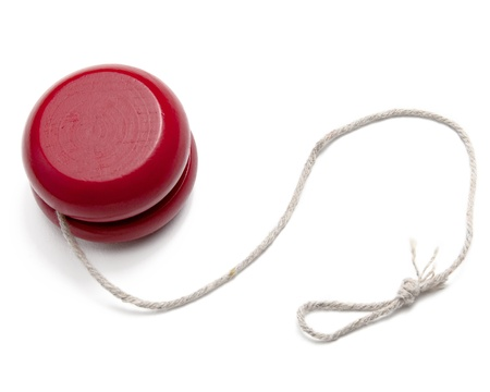 A red yo-yo yoyo with string isolated on white
