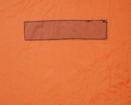 Rectangle stitched on a heavy orange vinyl fabric Stock Photo
